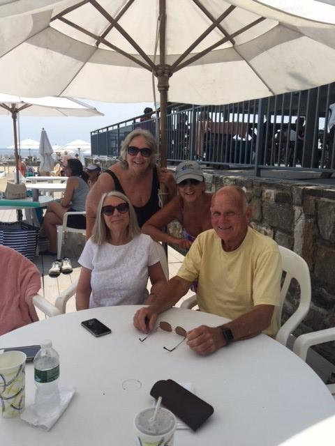 All four of Francis and Laura Ierardi's adult grandchildren on a sunny day at an outdoor restaurant.